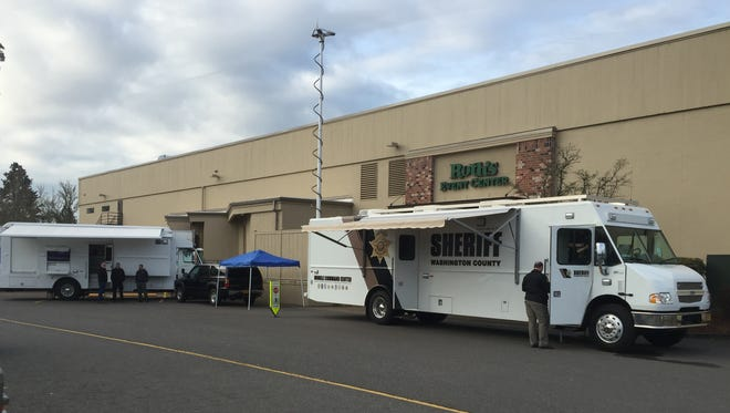 Salem Police want to scale up to a mobile command unit, like the ones pictured flanking the department's current set-up, a blue pop-up tent.