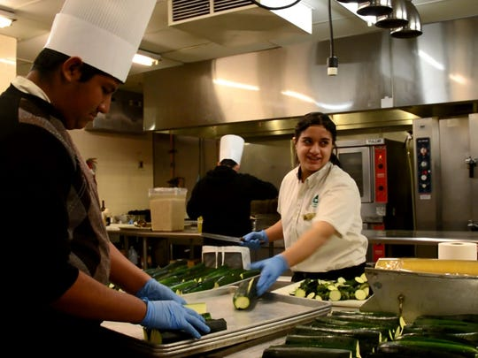 Students in the Hospitality, Recreation and Tourism Academy at Coachella Valley High School peel zucchini for the restaurants at the JW Marriott Desert Springs Resort and Spa. Hospitality students spend 15 weeks interning at the hotel as part of the academy program.