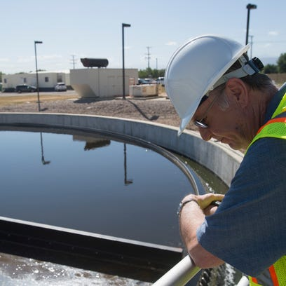 Plant Manager Michael McCrary looks down into a clarifier