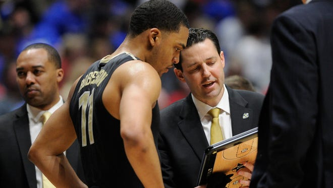 Vanderbilt Commodores forward Jeff Roberson (11) talks to  head coach Bryce Drew of their game in the 2017 SEC Men's Basketball Tournament at Bridgestone Arena Friday, March 10, 2017 in Nashville, Tenn.