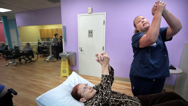 Occupational Therapist Katie Watkins (right) teaches Mary Mahoney, 84, a stretch for her shoulder during therapy at the Memphis Jewish Home and Rehab Wednesday morning. The Cordova facility is in the midst a $7.5 million renovation which will greatly expand the space and capabilities of it's rehabilitation program.