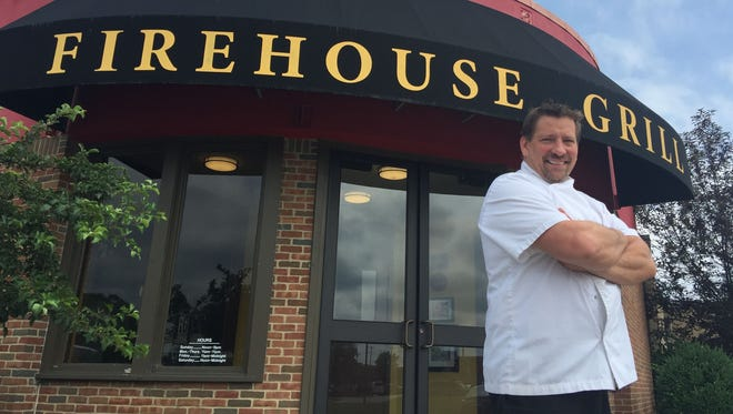 David Cook in front of The Firehouse Grill in Blue Ash, where he is now executive chef