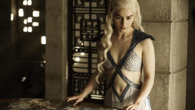 """In this image released by HBO, Daenerys Targaryen, portrayed by Emilia Clarke, appears in a scene from season four of """"Game of Thrones."""" The 5th season of the show premiered on Sunday, April 12, 2015. (AP Photo/HBO, Helen Sloan)"""