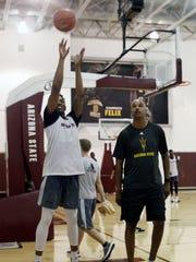 Freshman Kimani Lawrence practices free throws while