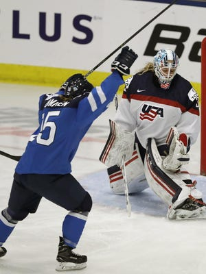 Finland defender Minttu Tuominen celebrates a goal on U.S. goalie Alex Rigsby. The U.S came back to win, 5-3.