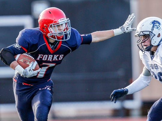Chenango Forks' Dan Crowningshield fends off Homer's Vincent Basile in the second quarter of Saturday's Class B state quarterfinal at Union-Endicott, Crowningshield rushed for 22 yards and threw a touchdown pass in the Blue Devils' 28-9 victory.