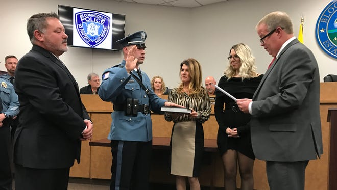 Bloomingdale Mayor Jonathan Dunleavy swears in new police officer Antonio Calabro during a meeting of the Bloomingdale Governing Body. Pictured left to right is Calabro's father, Angelo Calabro, his mother Denise Calabro, and his girlfriend, Danielle Schumelle. The ceremony was held Nov. 22, 2016.