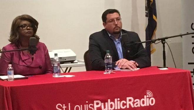 Ella Jones, a member of the Ferguson, Mo., city council, and Mayor James Knowles listen to a resident's question at a March 27, 2017,  election forum. Jones is vying to unseat Knowles in the first mayoral election in the city since the controversial police shooting death of Michael Brown led to widespread protests in the city.