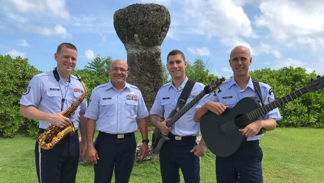 Technical Sergeant Ryan Leatherman, Staff Sergeant Freddie Cruz, Senior Airman Andy Detra and Senior Airman Guy James perform as part of the US Air Force Band of the Pacific ensemble Papana.