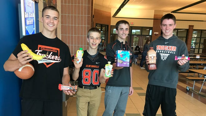Clintonville students get nutrition advice from Shari DeLisle, their school's licensed athletic trainer from ThedaCare. High protein, low sugar choices help fuel long days at school and sports practice.