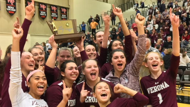 Members of the Verona volleyball team celebrate with the program's first group title.