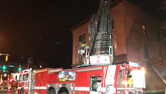 Rochester firefighters on scene of a two-alarm fire at 699 S. Clinton Ave. Tuesday night.