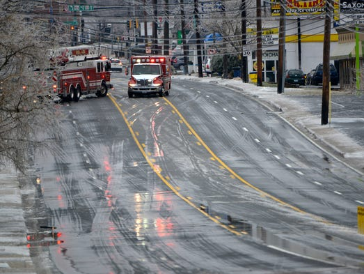 Emergency personnel close a major road where a power