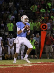USJ's Jacob Buie stands alone in the pocket before