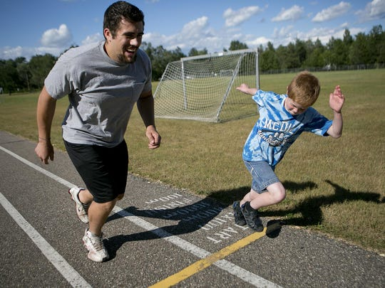 Little Brother Alex Slowinski, 9, of Plover challenged his Big Brother Zach Lentz, left, to a race around the track at the Plover-Whiting Elementary School playground in Plover Thursday. Lentz and Slowinski participate in Big Brothers, Big Sisters.