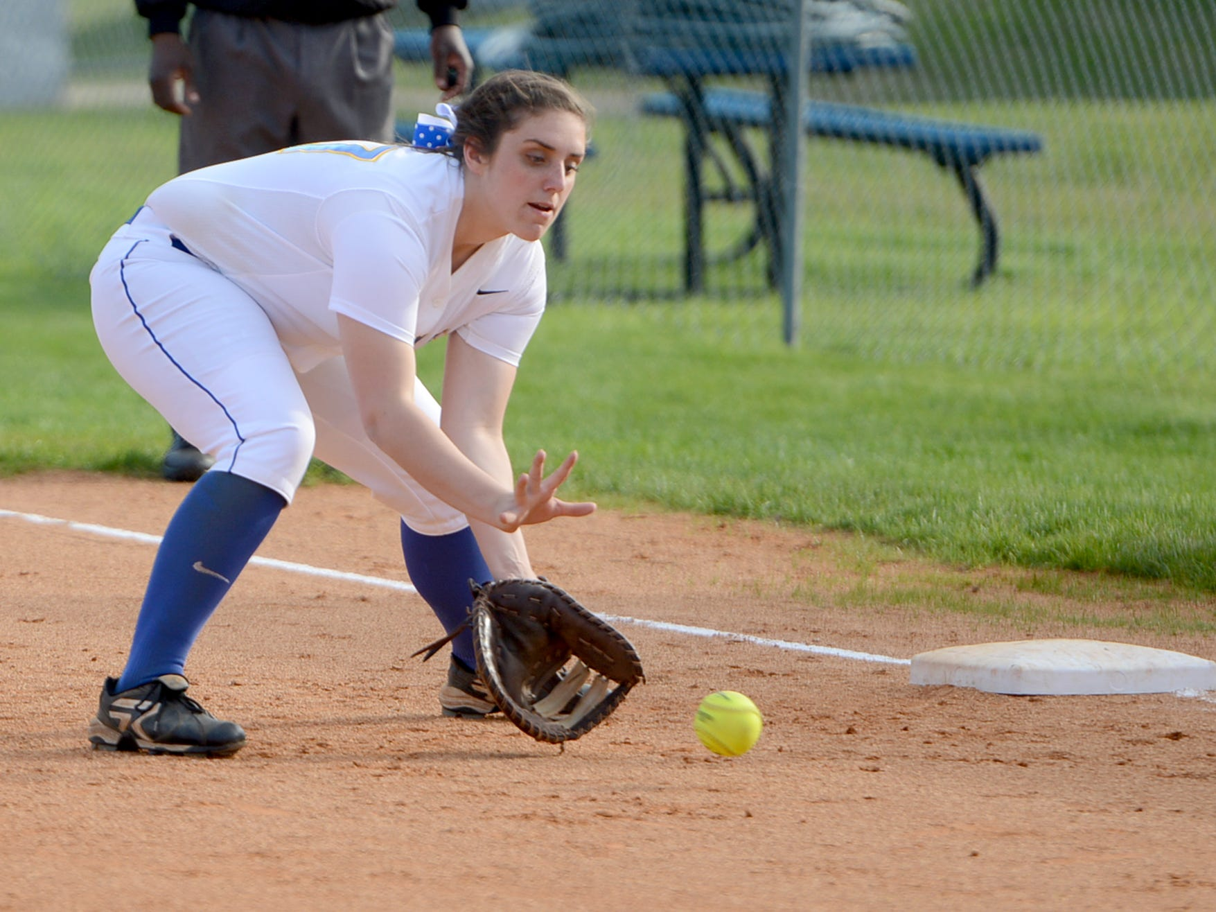 Jackson Christians' Courtney Kiestler gets down for a ground ball at first base during Monday's game against Madison.