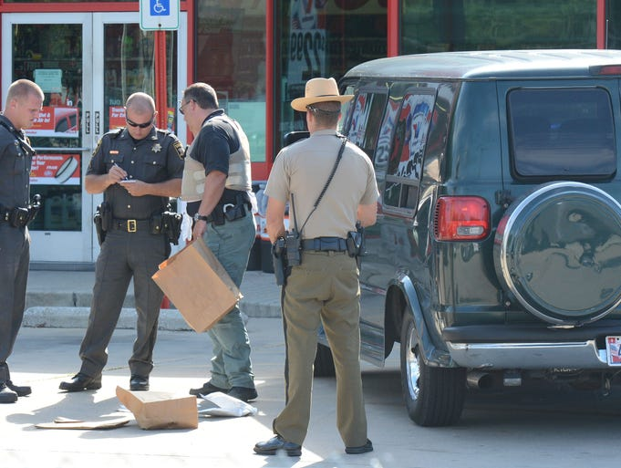 Salisbury Police, Wicomico County Sheriff Department and Maryland State Police take evidence into custody after a high-speed chase that led police through 3 counties Thursday morning and ending at the Auto Zone on Route 13 in Salisbury near the overhead bridge. The suspect was taken into custody.