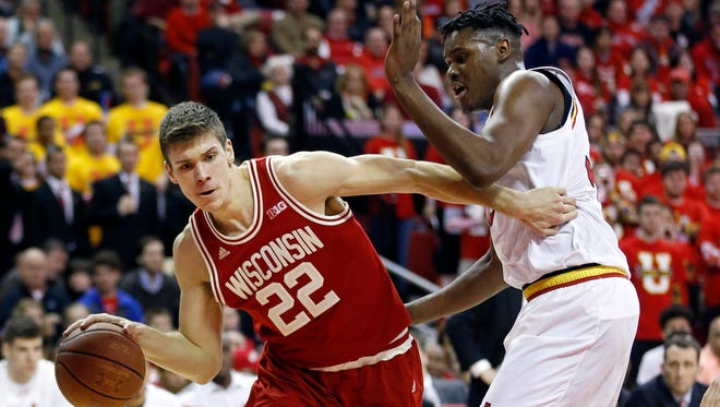 Wisconsin forward Ethan Happ, left, drives to the basket around Maryland center Diamond Stone during the first half on Saturday, Feb. 13.