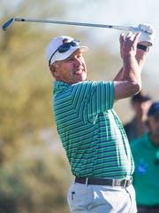 Former NFL great John Elway tees off on the 12th hole