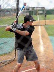 Hardin-Simmons outfielder Hunter Garrison stands in