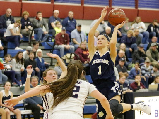 Courteney Crater of Notre Dame goes up for a shot against