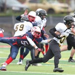Liggett's Caleb Stokes tackles Everest's Elliot Fenske during first half action on Saturday, October 18, 2014.