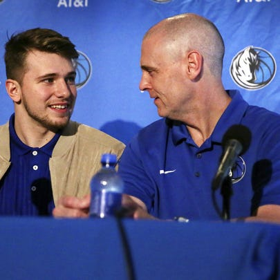 New Dallas Mavericks player Luka Doncic, center, speaks