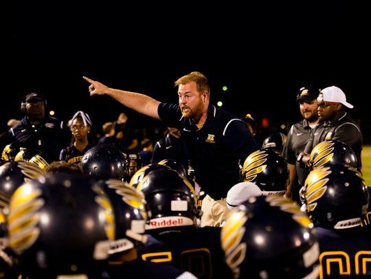 Northeast Head Coach Chad Watson yells at his team