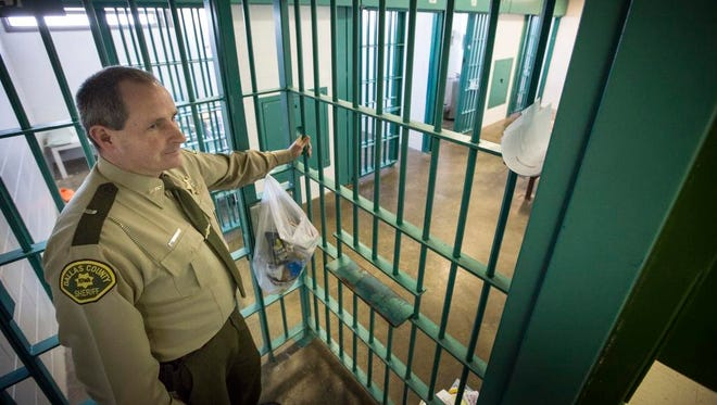 Dallas County Sheriff Chad Leonard showing a cell block in the jail Friday Feb 27, 2015.