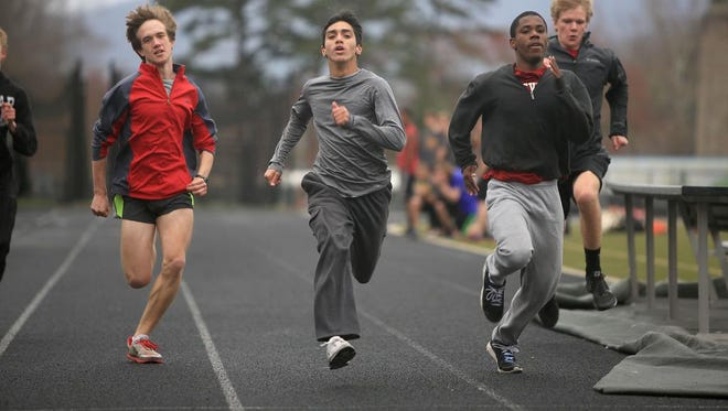 Members of the Asheville High School's boys track team run sprints during practice on Thursday.