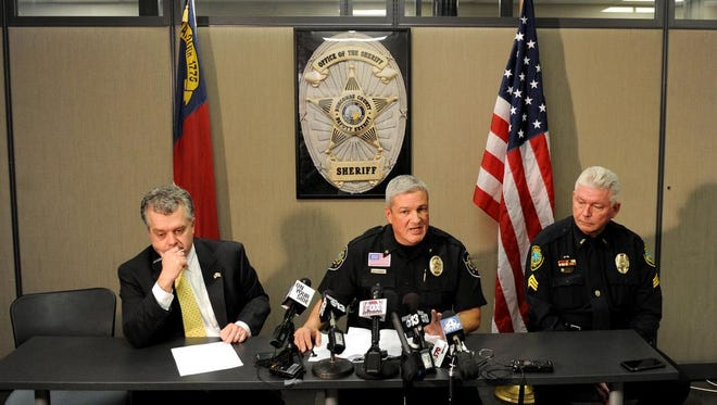 Buncombe County Sheriff Van Duncan, center, with Buncombe County District Attorney Todd Williams, left, and Asheville Police Department Sgt. Dave Romick speak about the deaths of Joseph and Cristie Codd and their accused killer Robert Jason Owens Friday afternoon at the Buncombe County Sheriff's Office at 339 New Leicester Highway.