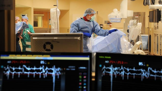 Members of a cardiac team prepare to remove a blood clot from patient Michelle Jenkins.