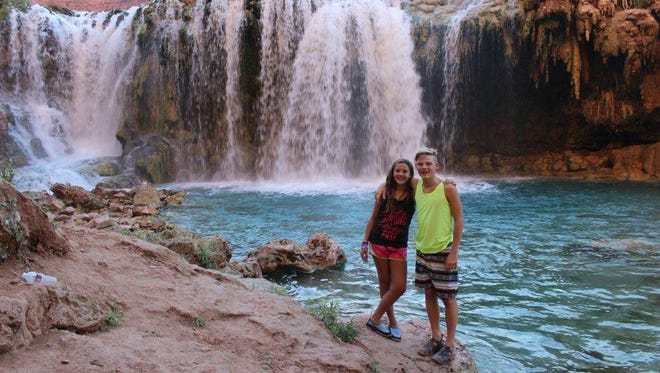 Christine Tanner's kids, Maddie, 13, and Callen, 14, visit Havasupai Falls during their three-day hiking trip to the Grand Canyon.