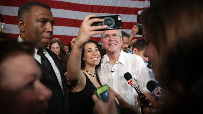 Jeb Bush greets people as he attends a fundraising event last week in Sweetwater, Fla.