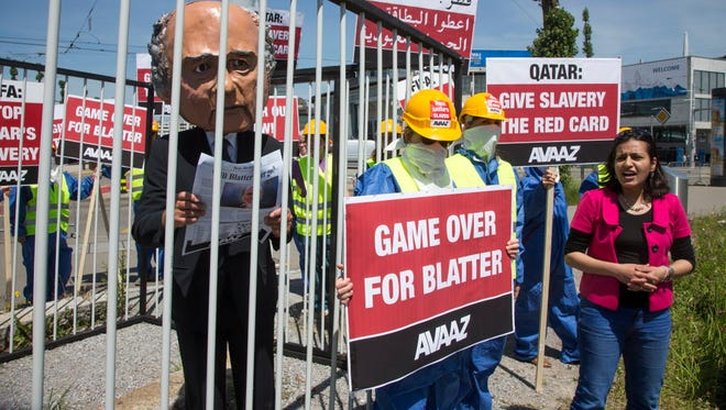 Protesters outside the annual meeting of the FIFA Congress on Thursday in Zurich demand President Sepp Blatter's resignation.