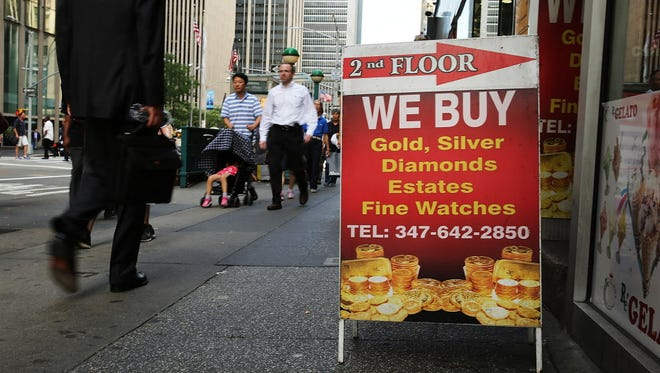 An advertisement for a jewelry store that buys and sells gold in New York.