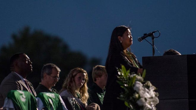 Student Government Representative Sandy Vang tearfully addresses the student body at the candlelight vigil to remember the four USC Upstate students who died in a car crash on Monday, October 12, 2015 at the USC Upstate soccer field in Spartanburg.