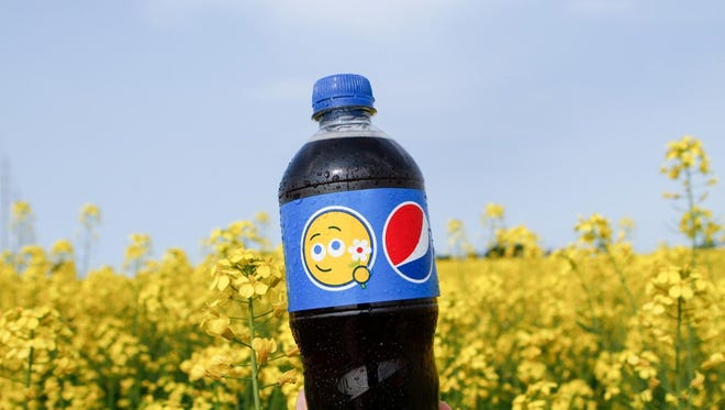 "This Pepsi bottle tagged with a flower-loving emoji was part of the ""Say It With Pepsi"" campaign test in Canada in summer 2015."
