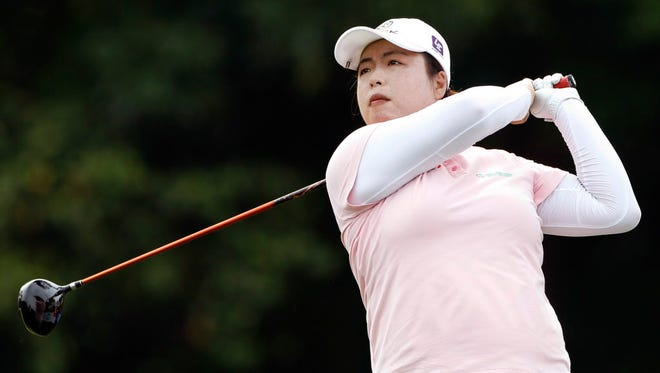 Shanshan Feng of China follows her shot on the second hole during the third round of the LPGA golf tournament at Tournament Players Club in Kuala Lumpur, Malaysia, Saturday, Oct. 29, 2016. (AP Photo/Joshua Paul) ORG XMIT: XJP112