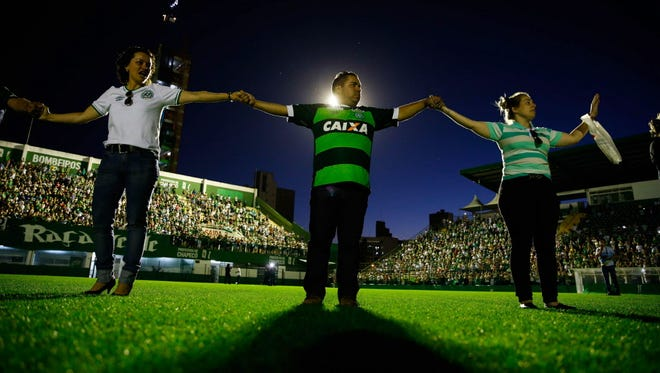 Relatives of players and managers of Chapecoense attend a vigil at the Arena Conda in Chapeco, Brazil.