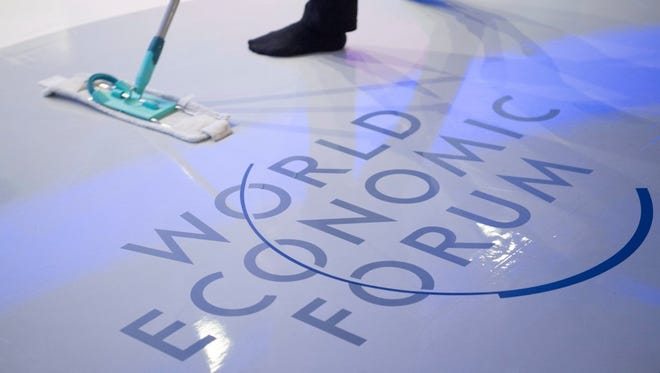 A woman cleans the stage prior a panel session on the closing day of the 47th annual meeting of the World Economic Forum, in Davos, Switzerland, on Jan. 20.