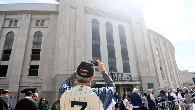 Jeff Romantz of Pennsylvania takes a photo of Yankee Stadium before the gates open for the Yankees home opener in Bronx, NY on Monday, April 10, 2017.