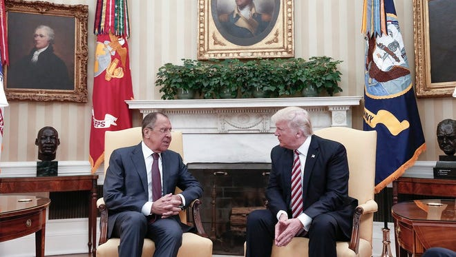 A file handout photo made available by the Russian Foreign Ministry shows US President Donald J. Trump (R) speaking with Russian Foreign Minister Sergei Lavrov (L) during their meeting in the White House in Washington, DC, USA, 10 May 2017 .