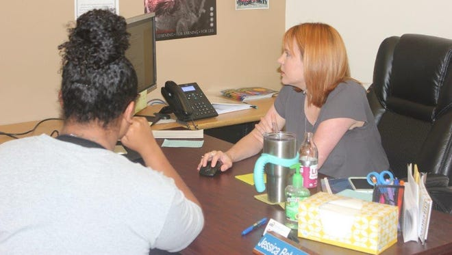 An advisor speaks with a student at Howard College in San Angelo.