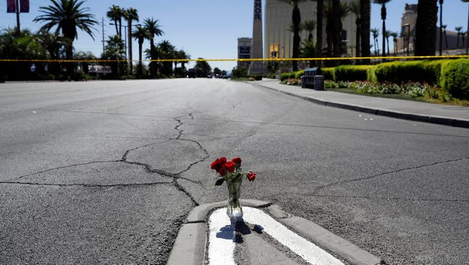 Flowers are placed near the scene of a mass shooting Monday, Oct. 2, 2017, that occurred at a music festival near the Mandalay Bay resort and casino on the Las Vegas Strip in Las Vegas on Sunday.