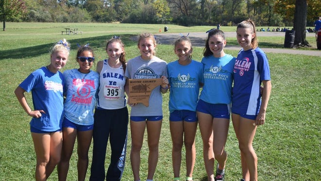 Salem's varsity girls cross country team celebrates he team's championship at Saturday's Wayne County Invitational.
