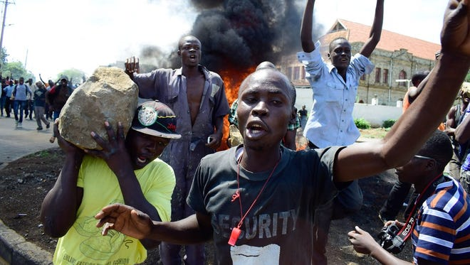 Supporters of National Super Alliance (NASA) presidential candidate Odinga demonstrate in the streets on the boycott of the upcoming elections on October 24, 2017 in Kisumu, Kenya.