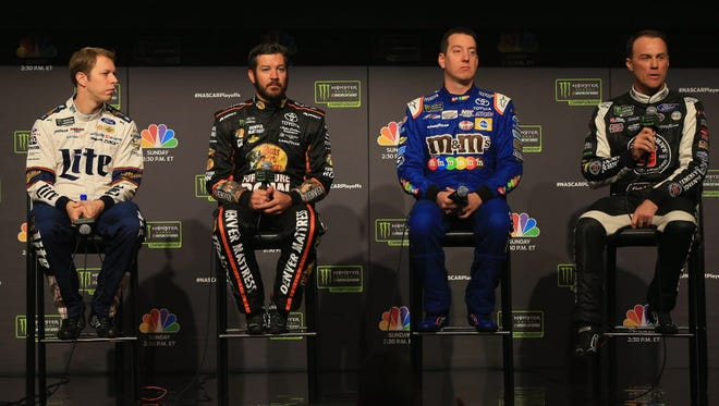 From left to right, Brad Keselowski, Martin Truex Jr., Kyle Busch and Kevin Harvick talk to the media during media day for the Monster Energy NASCAR Cup Series Championship at the Loews Hotel in Miami.