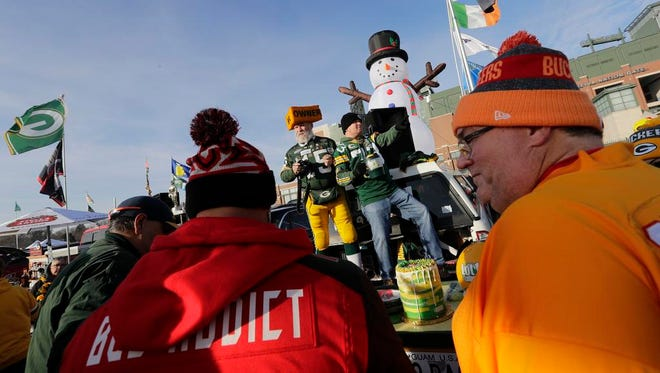 Green Bay Packers and Tampa Bay Buccaneers fans tailgate together Sunday, December 3, 2017, at Lambeau Field in Green Bay, Wis.