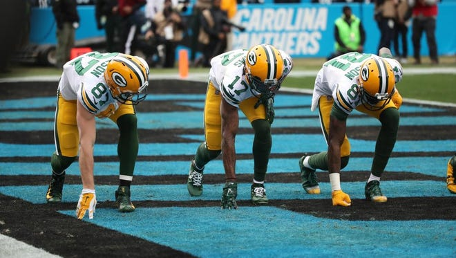 Green Bay Packers receivers Jordy Nelson (87), Davante Adams (17) and Geronimo Allison (81) celebrate Adams' first-quarter touchdown with a race walk on Sunday, Dec. 17, 2017, at Bank of America Stadium in Charlotte, N.C.
